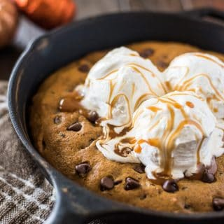 Treat your family to an easy seasonal treat - a big Pumpkin Chocolate Chip Skillet Cookie! Adding pumpkin and spices to classic cookie dough bakes up a soft, chewy cookie that you're gonna need a plate for!
