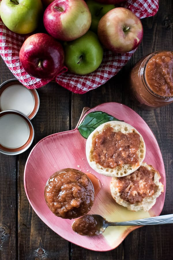 Invest your apple harvest in something you can enjoy all year long! Only all natural ingredients go in this set-it-and-forget-it Slow Cooker Apple Butter, and it's so good, you're going to be spreading it on everything!