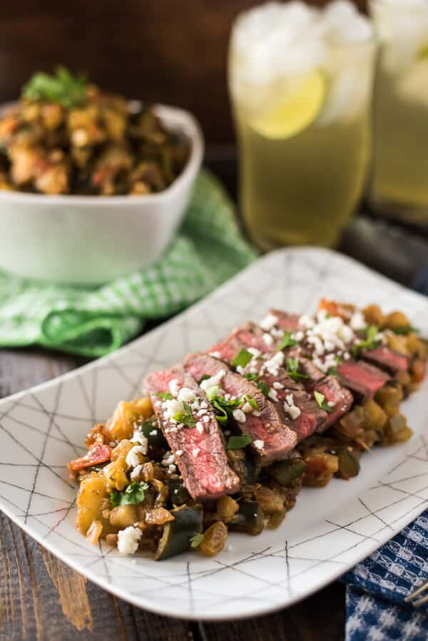 Heat up your next cookout with Spicy Grilled Steak Caponata! Classic eggplant caponata + hot peppers & salsa verde + perfectly grilled steak & crumbly cheese = a recipe for late summer salad perfection!