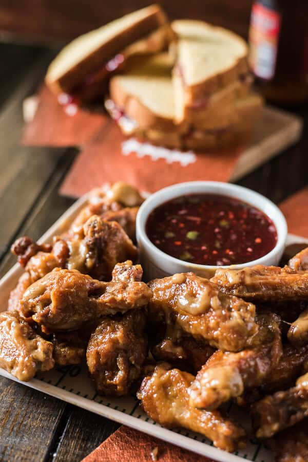 Calling all football fans - Spicy PB&J Wings are here turn a famed childhood sandwich into your new favorite tailgating snack! Dip these peanut butter glazed chicken wings into the strawberry jalapeno glaze and cheer louder than ever before!