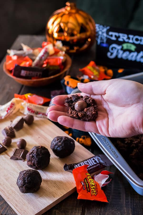 Re-purpose some of that trick-or-treat loot in a batch of these Candy Bar Truffles - chewy, fudgy brownie balls stuffed with your favorite Halloween candy and dipped in chocolate!