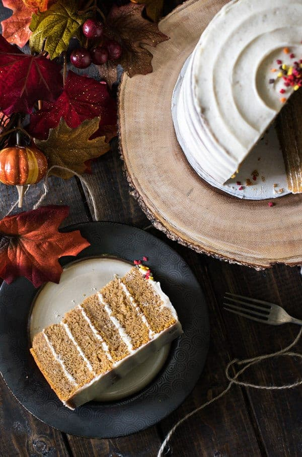 This Pumpkin Layer Cake with Brown Butter Cream Cheese needs to be on your holiday menu! Six layers of super moist spiced pumpkin cake, crowned with the most delicious cream cheese icing imaginable - you'll flip for the flavor!