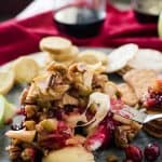 This simple Cranberry Apple Pecan Baked Brie combines tart, sweet, and savory to create an elegant holiday crowd pleaser!