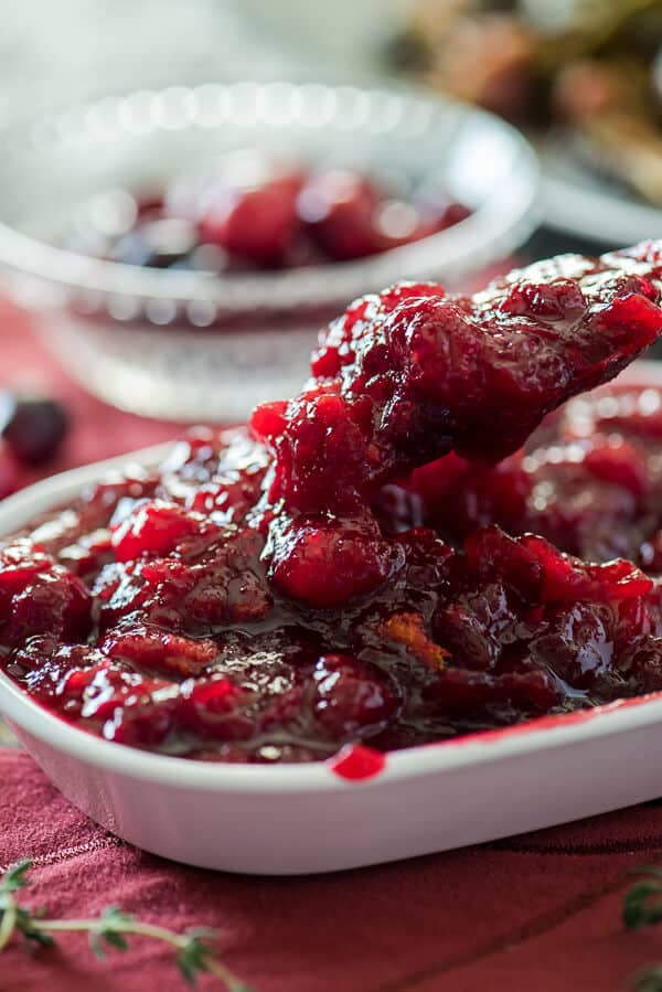 Never open a can of jellied cranberries again! This quick Last-Minute Cinnamon Cranberry Sauce is so simple, you'll be volunteering to bring the sides to every holiday dinner!