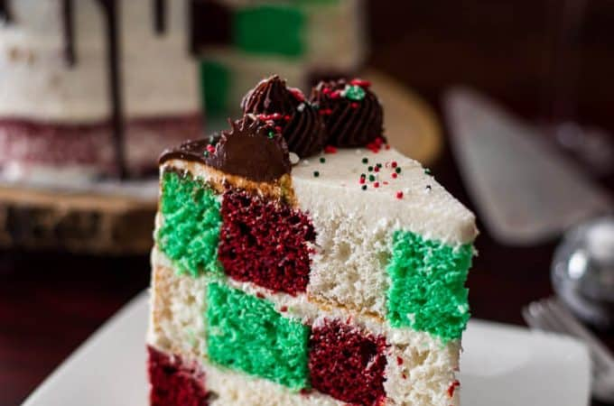 Cake deserves its time to shine on your holiday table, and this Christmas Checkerboard Cake is just the thing that's going to put all the cookies and pies to shame! Three festive colors, two types of icing, and a bunch of sprinkles make this baby the star of the show!