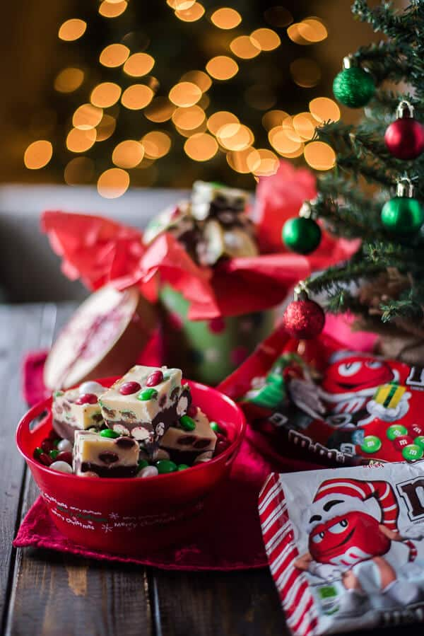 This Triple Chocolate M&M Peppermint Bark Fudge turns three holiday favorites in one! Soft, minty chocolate and white chocolate fudge studded with holiday M&M'S® is a fun treat to eat and gift!