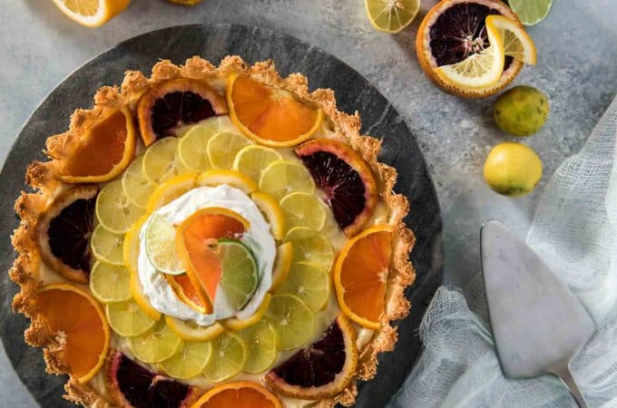 When one pie flavor just won't do - you combine three! This Triple Citrus Macaroon Mascarpone Tart is the perfect blend of sweet & tart, dense & fluffy, and is nestled in a (surprise!) coconut macaroon shell.