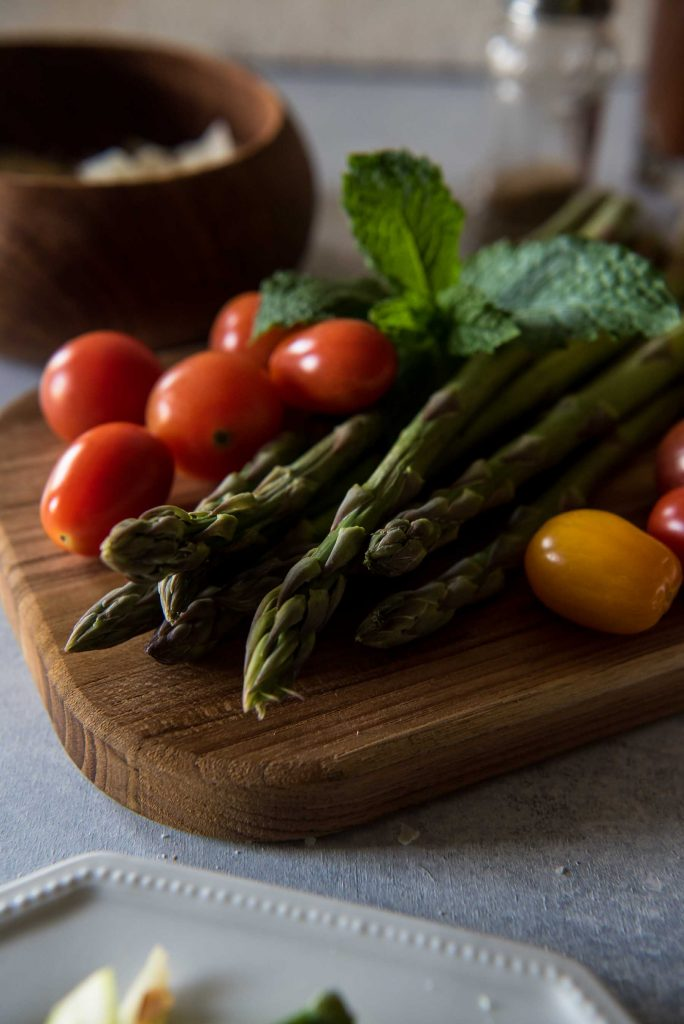 Spring has sprung, and its vegetables are at their peak! This Spring Asparagus Salad is a wonderful way to showcase raw asparagus - thinly sliced and tossed with tomatoes, almonds, Parmesan, mint, and a simple lemon vinaigrette.