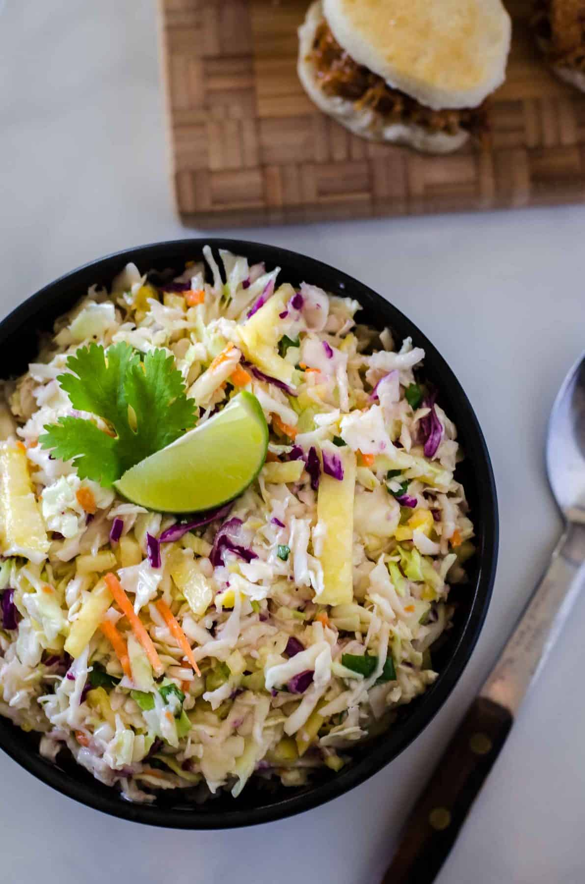 Bring the best dressed slaw to your next BBQ! This fast & easy Fresh Pineapple Coleslaw adds a little tropical flair to the otherwise ordinary side, making it a great topping for everything from sliders to hot dogs!