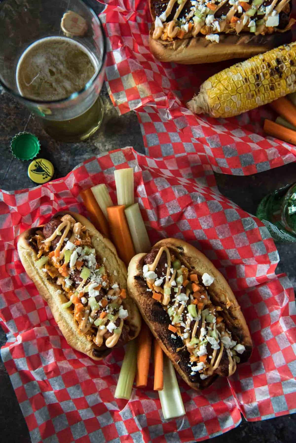 Summer grilling with a kick! Top your Buffalo Hot Dogs with shredded Buffalo chicken, zesty Buffalo mayo, chopped celery & carrots, and blue cheese (or Feta for BCHaters) for a change of pace in your hum-drum dog game!