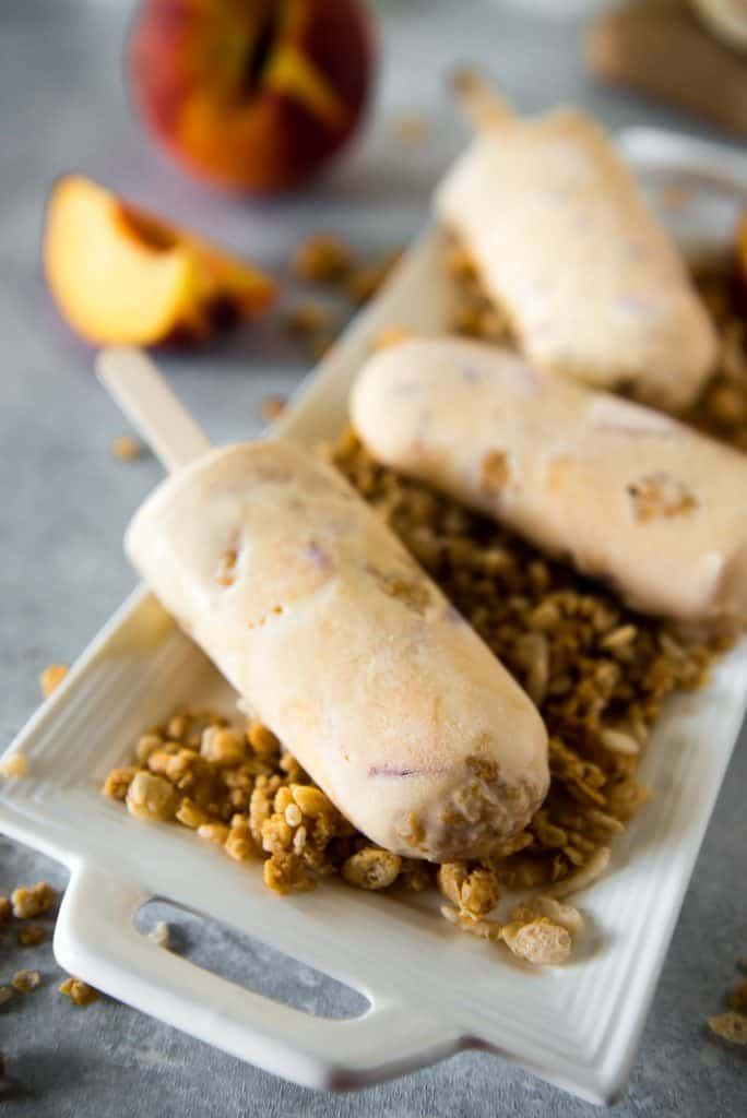 This cool dessert pops! These Caramel Peach Crisp Ice Cream Pops combine the goodness of summer peaches and the fun of a crumbly crisp with rich, creamy, light caramel ice cream.