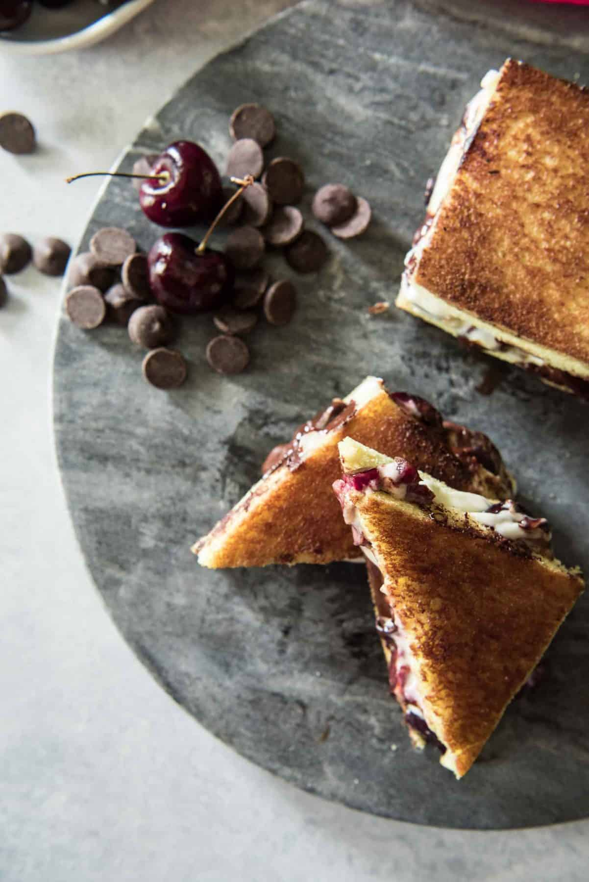 Prepare to appreciate sandwiches in a whole new way with this Dark Chocolate Cherry Dessert Grilled Cheese! Fresh bing cherries, sweetened Mascarpone, and luscious dark chocolate melted on brioche make this a sandwich destined for your dessert menu!