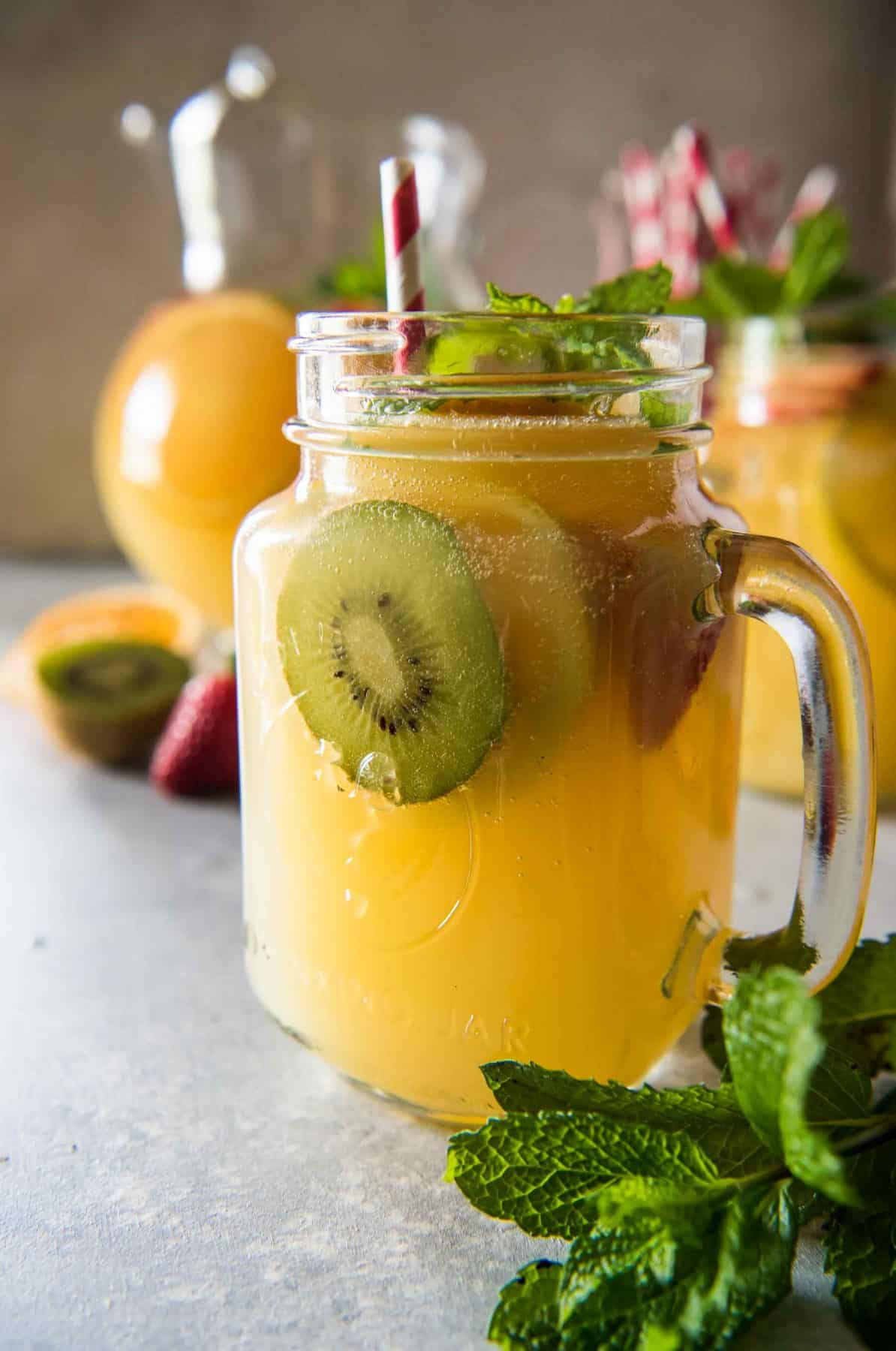 Cool down these hot summer days with a pitcher of Orange Lemonade Twist Punch! Fizzy, spicy, and fruity, this refreshing drink is sure to wow your friends & family!