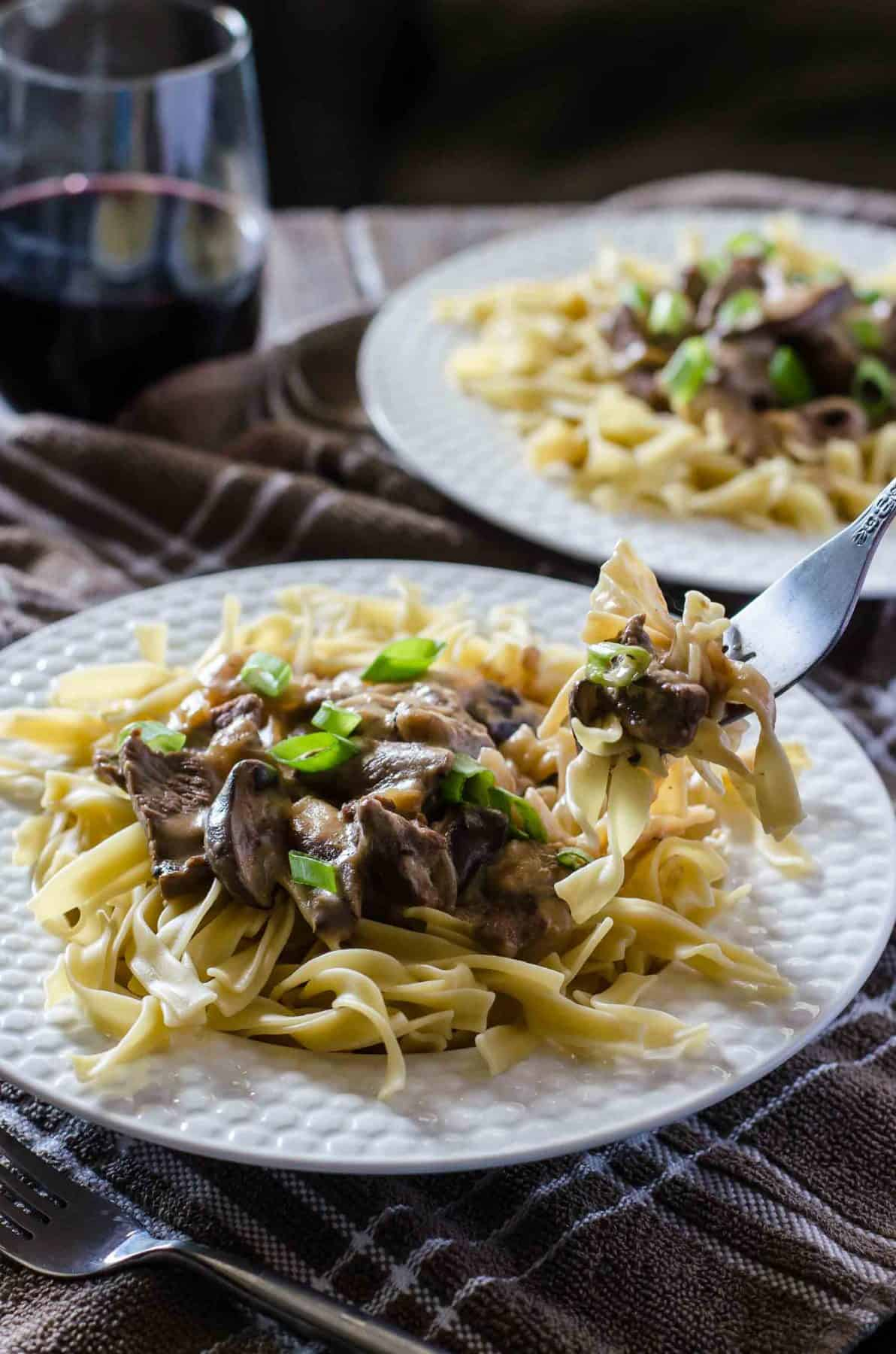 This classic Beef Stroganoff recipe comes together in less than 30 minutes! Choose your favorite cut of steak and cook it in an amazing creamy mushroom sauce, then serve it all over egg noodles for a fabulous hot lunch or dinner.