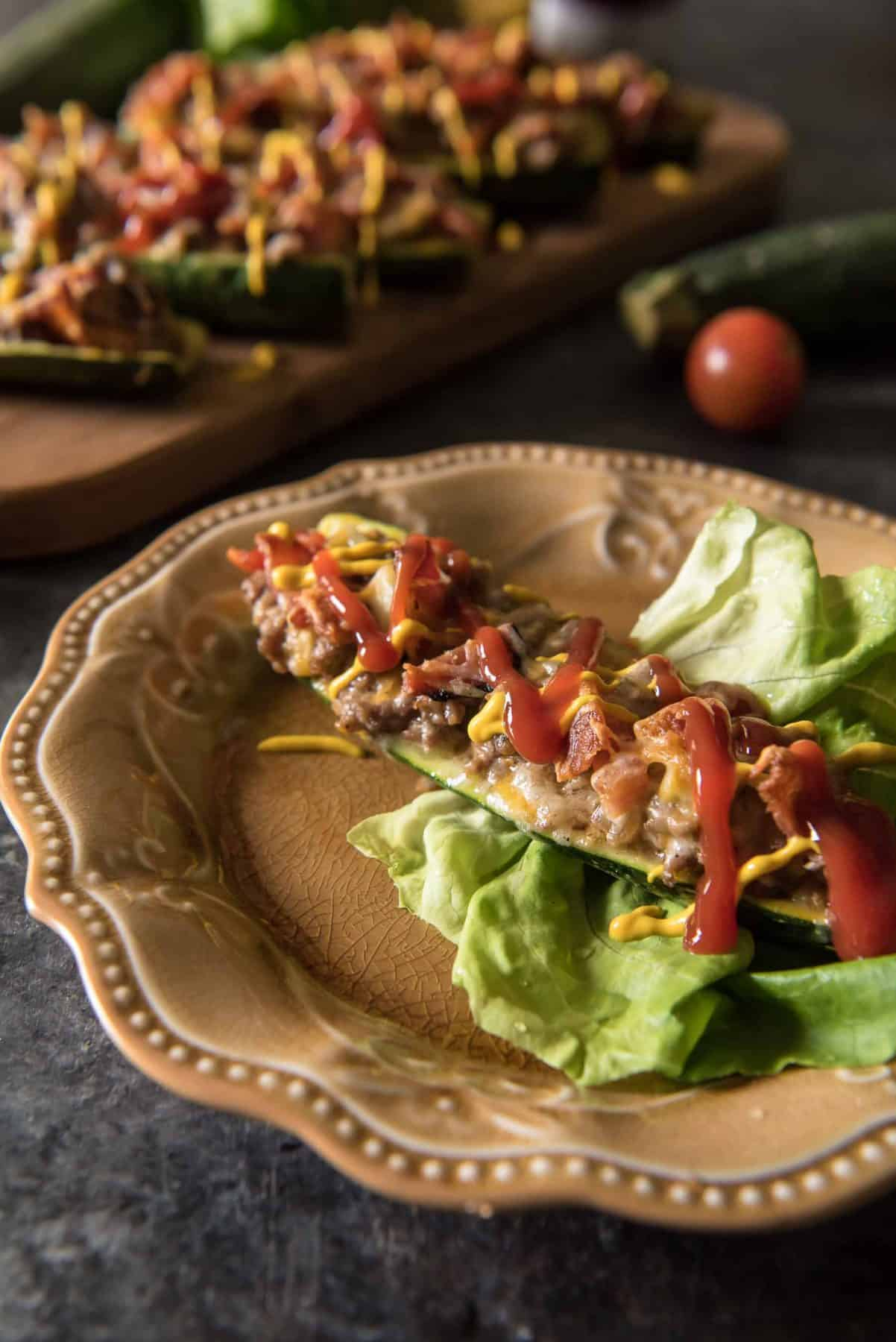 These low-carb, keto-friendlyBacon Cheeseburger Zucchini Boats are surprisingly filling! They're loaded with cheese and all the flavors of your favorite burger, and will easily calm your craving for one - without the bun!