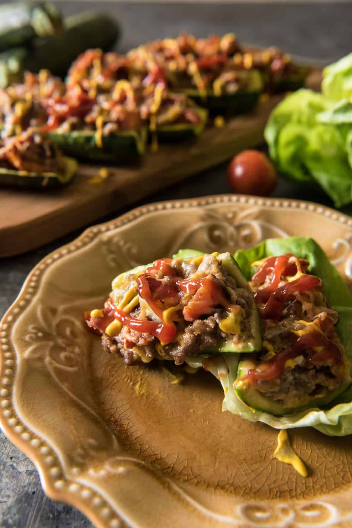 These low-carb, keto-friendly Bacon Cheeseburger Zucchini Boats are surprisingly filling! They're loaded with cheese and all the flavors of your favorite burger, and will easily calm your craving for one - without the bun!