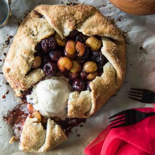 This Cherry Almond Galette is a gorgeous way to show off your favorite summer fruit! A rustic, flaky, sugar-kissed almond pastry, brimming with balsamic glazed cherries...a scoop of ice cream is all you need for a perfect dessert!