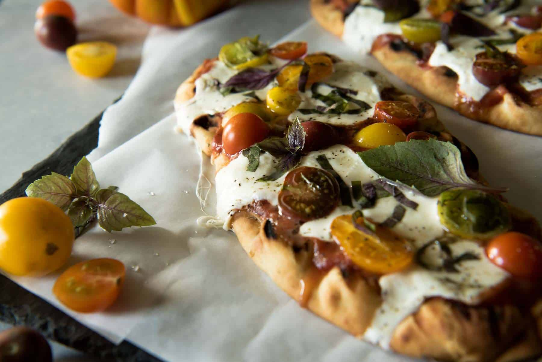 In need of a quick weeknight dinner? This Grilled Margherita Flatbread is all the delicious pizza taste you want with much less work.