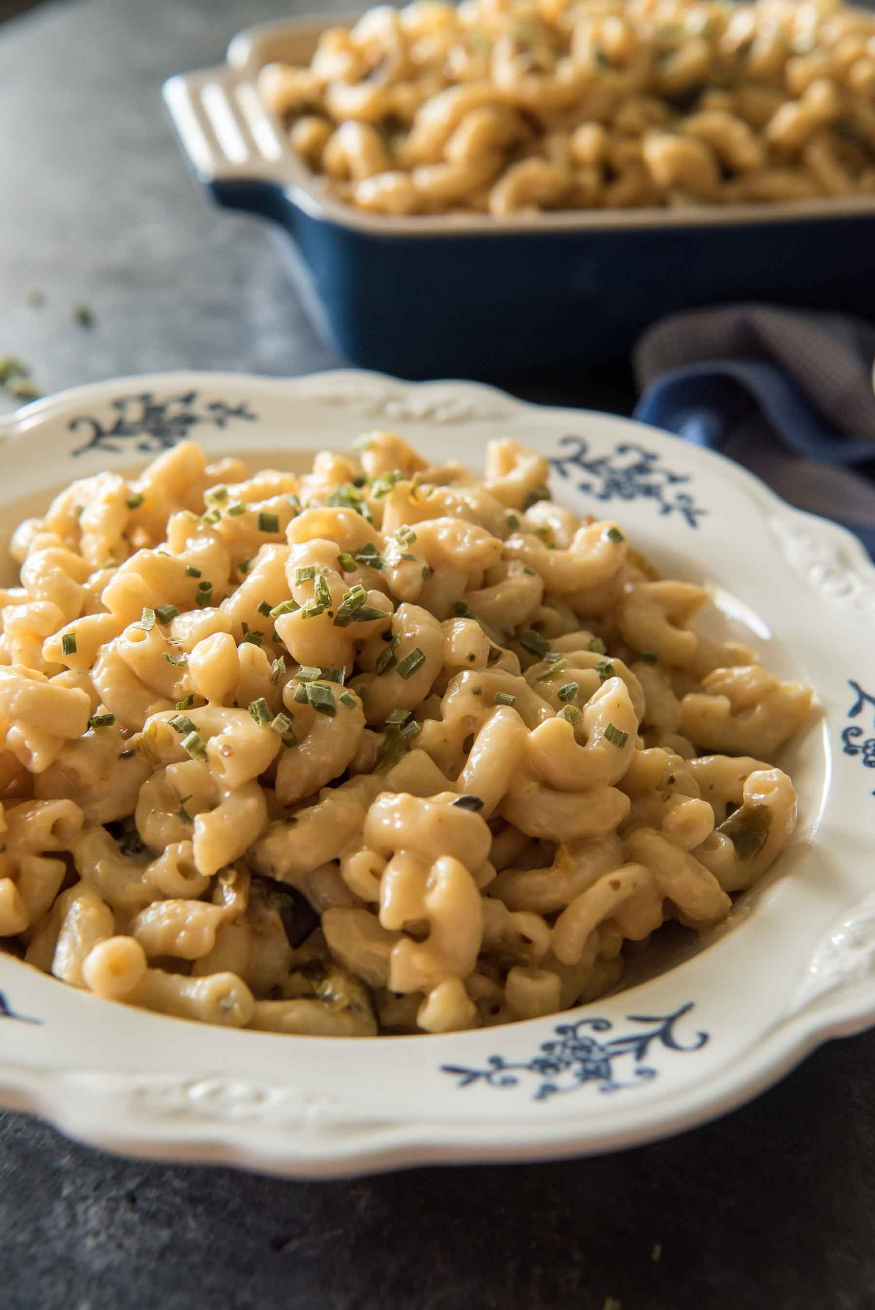 Fresh jalapenos heat up this Instant Pot Mac and Cheese with Roasted Poblanos - but delicious, creamy layers of cheese cool it all down, making this side dish perfect for all ages & palates!