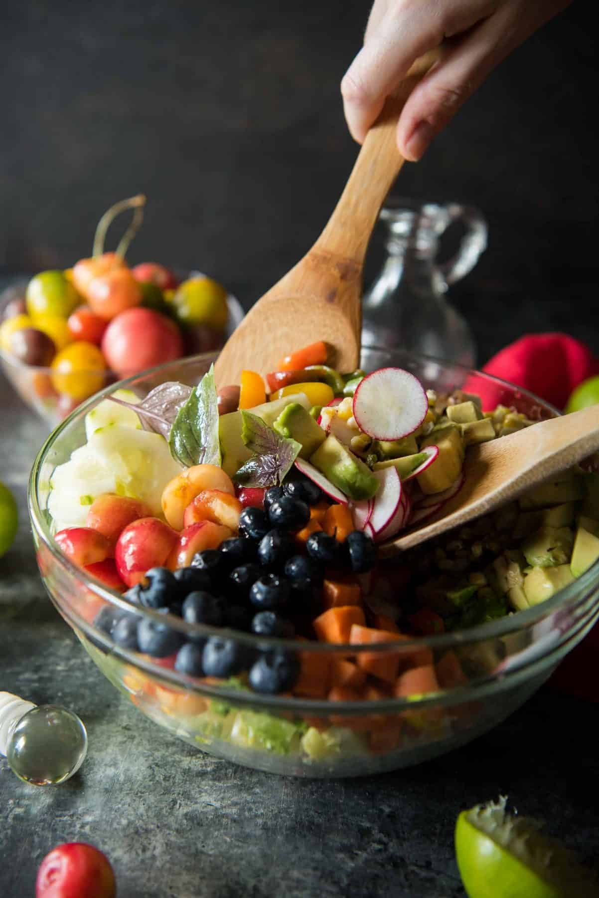 Summer lovin' in a salad! Grilled chicken, grilled corn, fresh cherries, blueberries, and avocado are tossed with standard salad fare and a tangy lime vinaigrette - creating a crunchy Summer Chopped Salad that's perfect for any meal!
