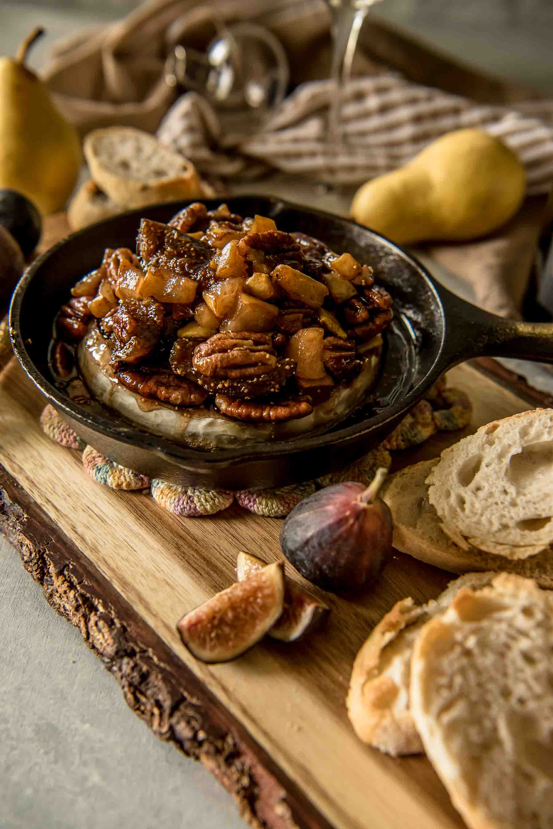 This creamy Brown Butter Fig & Pear Baked Brie is both elegant and comforting, and is sure to be the hit of any holiday or cold weather party! Figs, pears, pecans, and a little sweetness bring out the best in your favorite soft cheese.