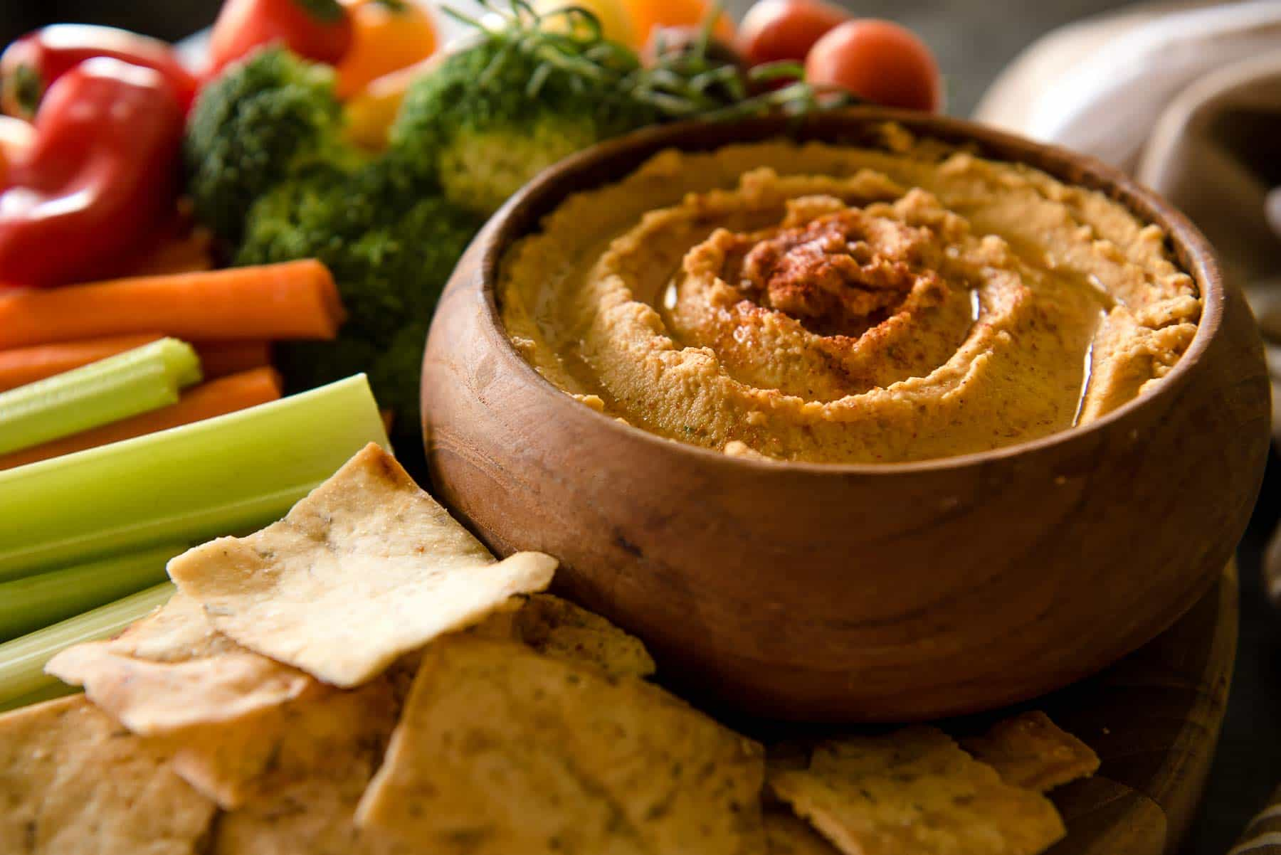 Everything you love about your favorite hummus with a little bit of fall added in - this savory Roasted Garlic Pumpkin Hummus takes just 5 minutes to make, and will please every palate!