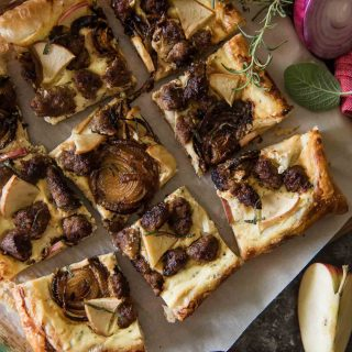 Caramelized onions, spicy Italian sausage, and sweet apple on an herbed ricotta, spread over puff pastry - whether served as an appetizer or snack, this Savory Apple Sausage Tart is sure to please any fall flavor-loving crowd!
