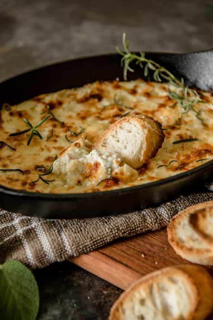 Warm, salty, and extra cheesy, this Baked Ricotta Dip is a delicious appetizer for any occasion. Serve it with slices of your favorite toasted bread and you'll find it hard to stop eating!