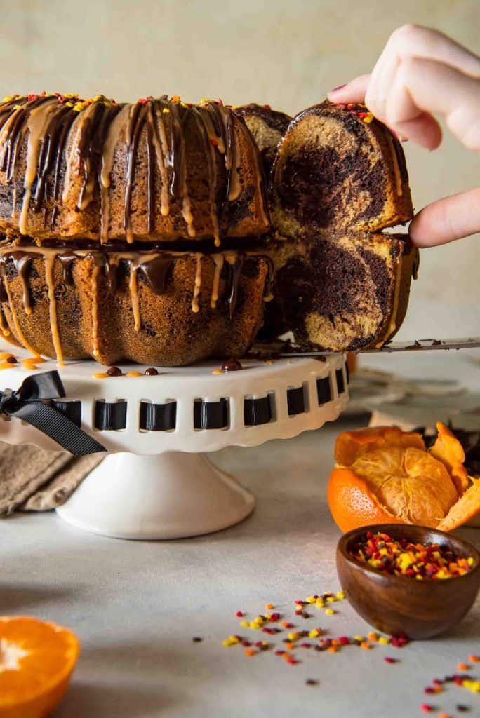 This moist, tasty Chocolate Orange Marble Bundt can be made in any pan, but is extra festive stacked as a fun fall pumpkin! Drizzle it with ganache and orange glaze for even more flavor!