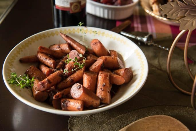 A little sweet, a little spicy, and totally delicious, these Red Wine & Maple Glazed Carrots are about to be your new favorite side dish!