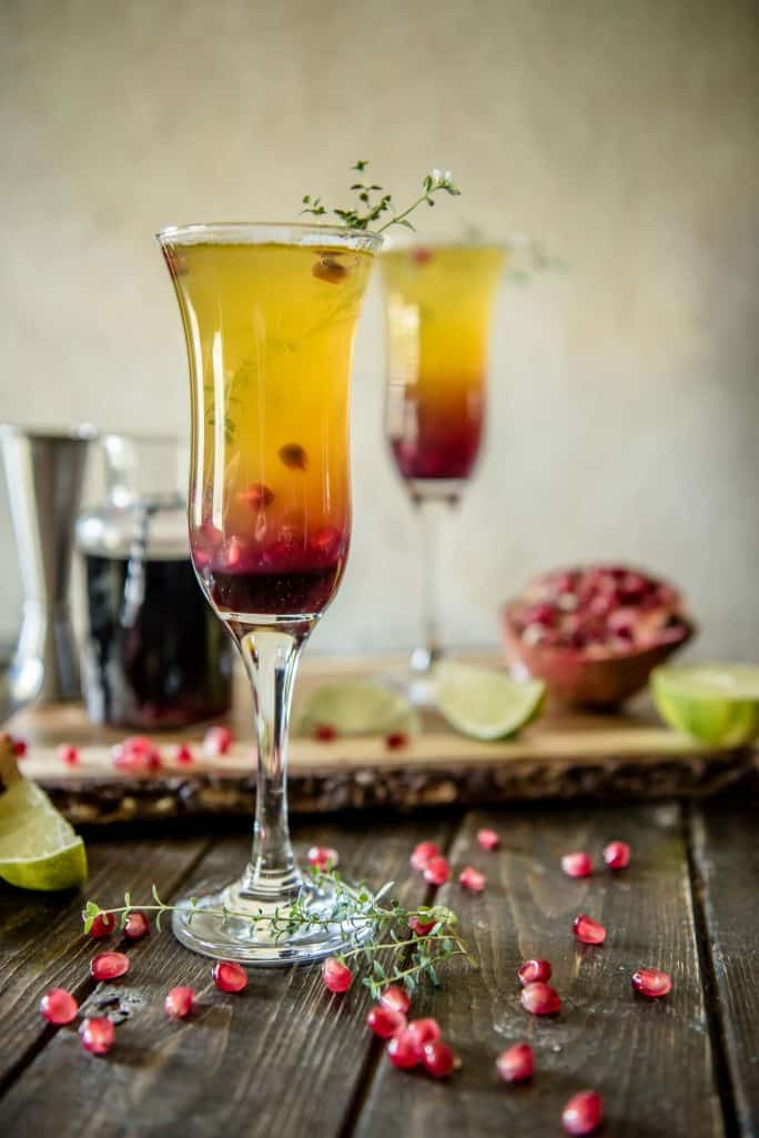 Passion fruit, pineapple, and pomegranate make this fiery Southern Autumn Sunrise Cocktail as welcome on a cool day as it is on a hot day!