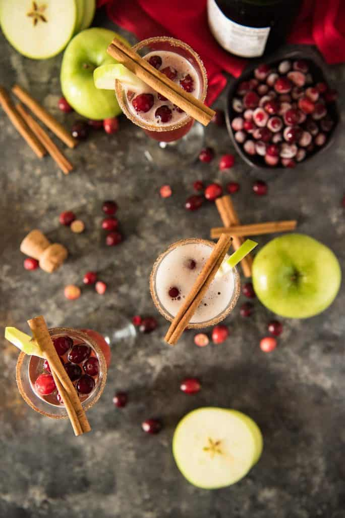 These fun and festive 3-ingredient Apple Cranberry Mimosas will make any holiday breakfast extra special - just don't forget the cinnamon-sugar rim!