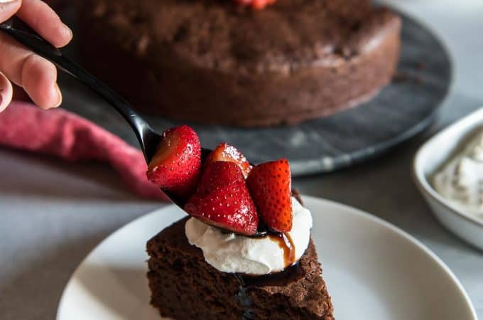 Chocolate Beet Cake with Balsamic Berries and Whipped Mascarpone spooning strawberries