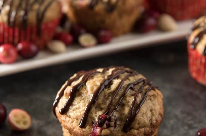 Banana Cranberry Pistachio Muffins with Chocolate Glaze