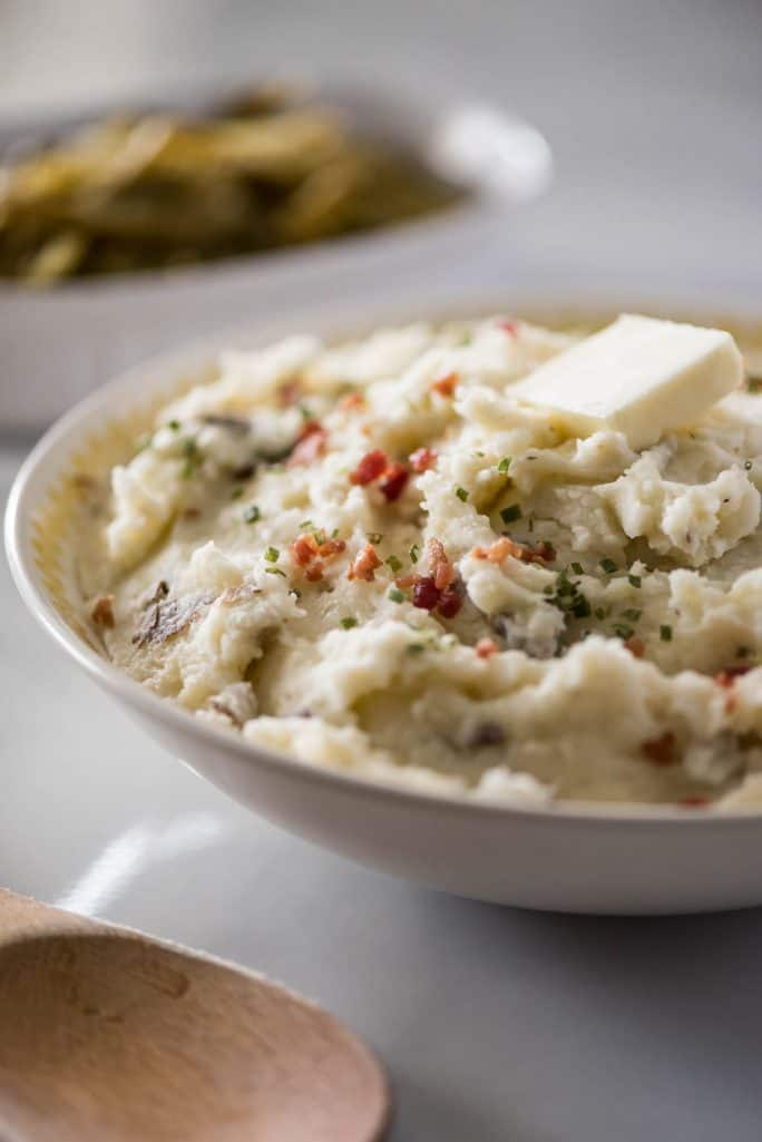 These Homestyle Garlic Herb Mashed Potatoes are a must at every family dinner & holiday celebration! Creamy, buttery, and wonderfully herby, this purely comforting mashed potato recipe is our favorite!