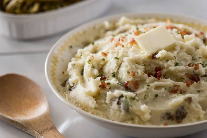TheseHomestyle Garlic Herb Mashed Potatoes are a must at every family dinner & holiday celebration! Creamy, buttery, and wonderfully herby, this purely comforting mashed potato recipe is our favorite!