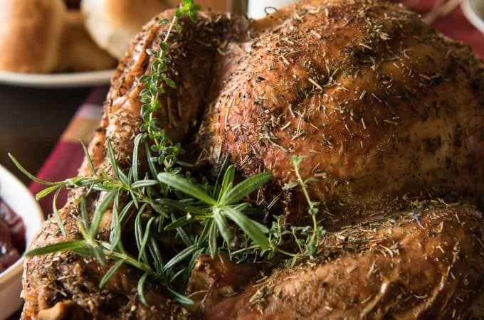 The juiciest holiday bird you'll ever eat! This White Wine and Herb Roasted Turkey is stuffed with fresh root veggies, bathed in white wine, and rubbed with a cocktail of herbs that is guaranteed to delight everyone at the table!