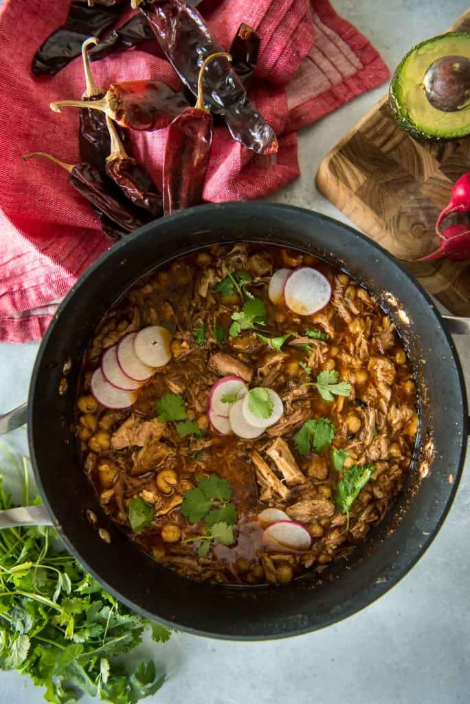 Posole Rojo: The Best Pork and Hominy Stew inside pot