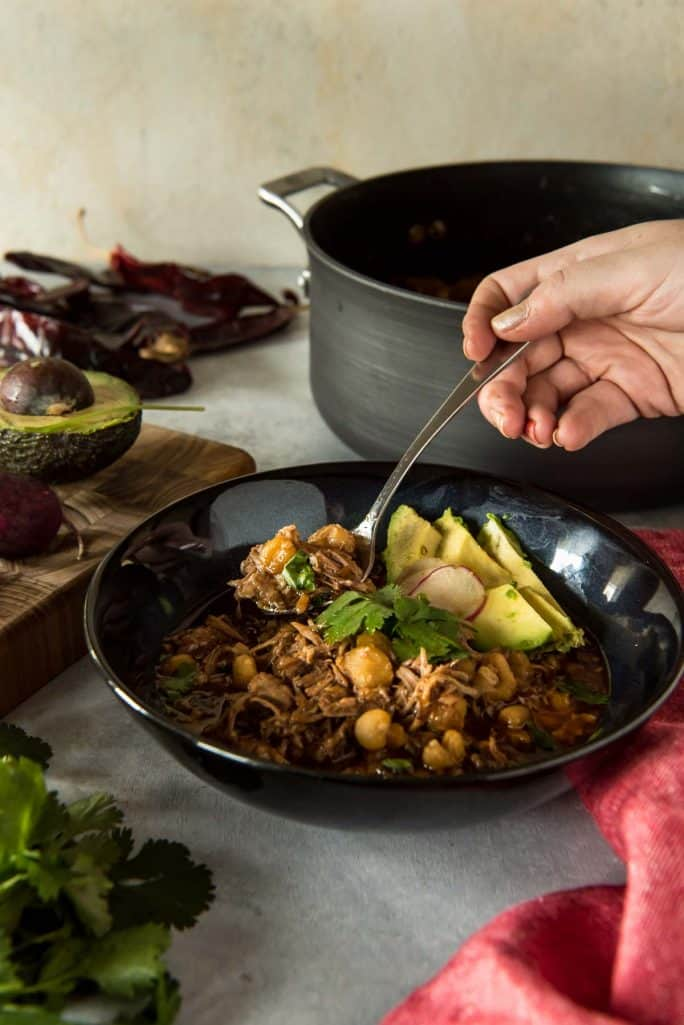 Posole Rojo: The Best Pork and Hominy Stew spoon