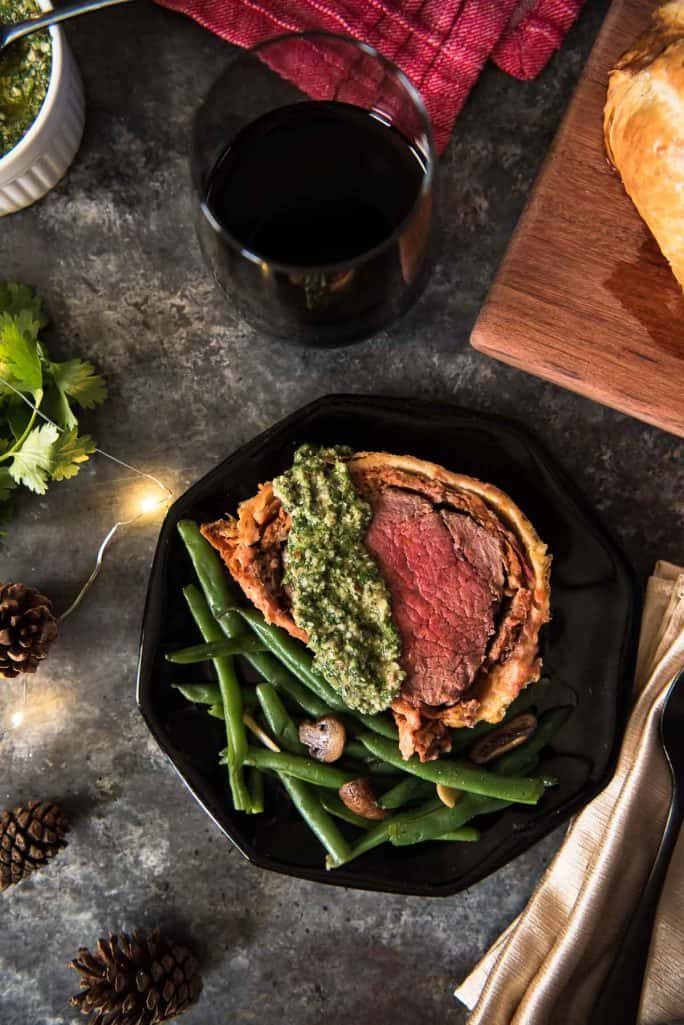 Chorizo Beef Wellington with Cilantro Pesto slice flatlay