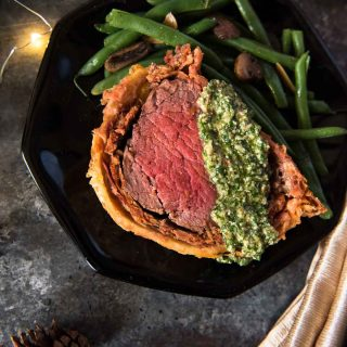 Chorizo Beef Wellington with Cilantro Pesto slice closeup