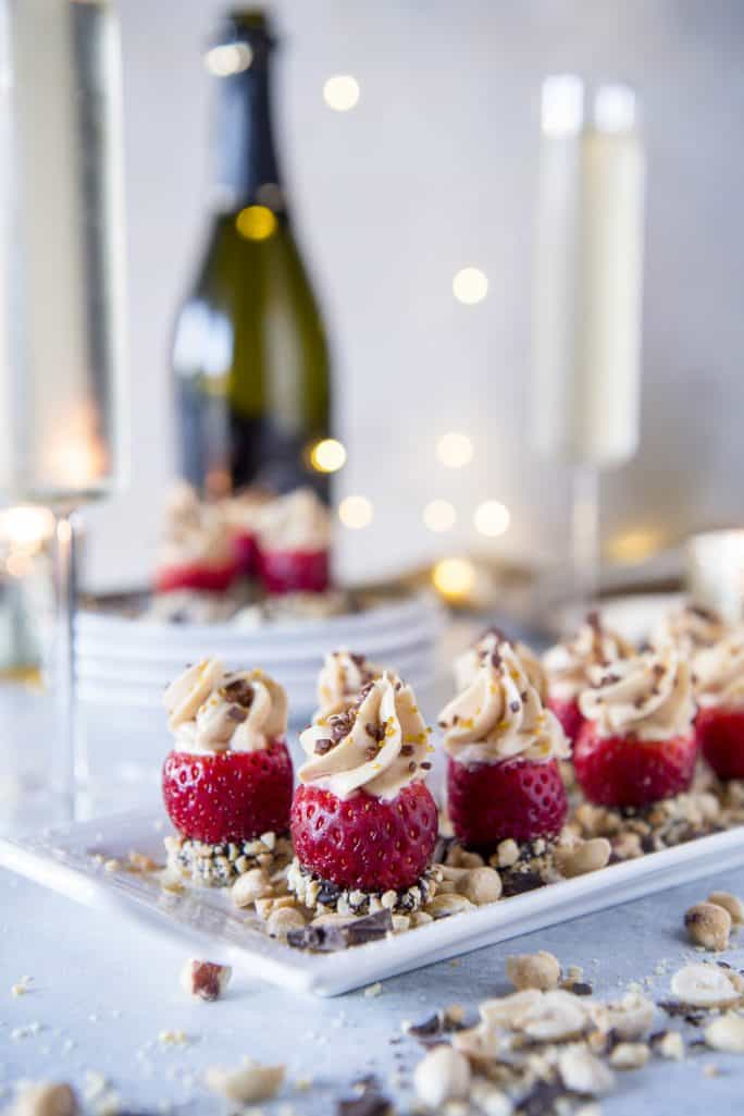 Peanut Butter Cheesecake Stuffed Strawberries on party table