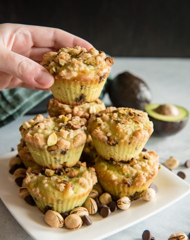 Grabbing Avocado Chocolate Chip Muffins with Pistachio Crumble