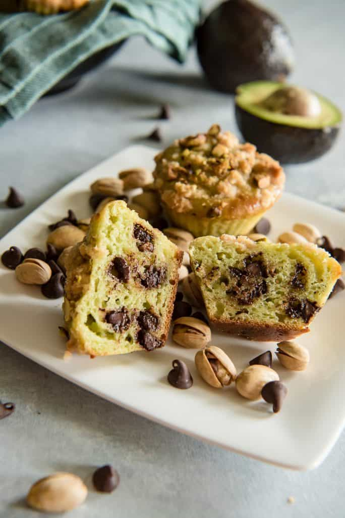 Avocado Chocolate Chip Muffins with Pistachio Crumble cut in half