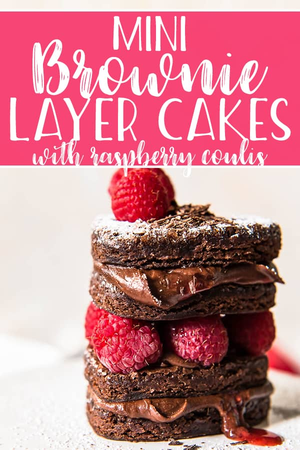 These sweet Mini Brownie Layer Cakes will be a hit with everyone you love! Heart-shaped layers of fudge brownie filled with chocolate fudge frosting and raspberry jam are meant for sharing!
