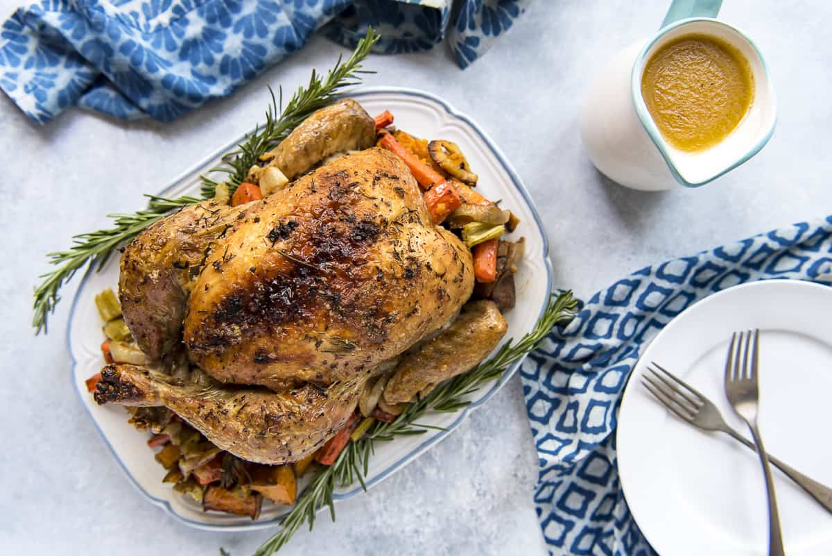 Juicy Herb Butter Oven Roasted Chicken With Pan Gravy The Crumby Kitchen
