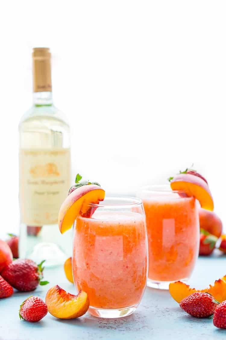 21 Refreshing Summer Cocktails Perfect for Brunch - Strawberry Peach Wine Slushies