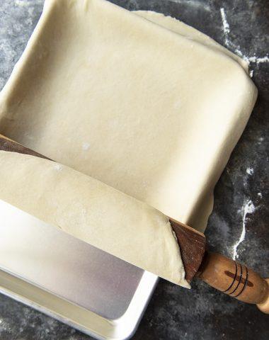 The Best Flaky Pie Crust Recipe rolled in pie pan