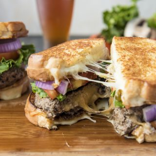 Grilled Cheese Beef and Mushroom Juicy Lucy cheese pull