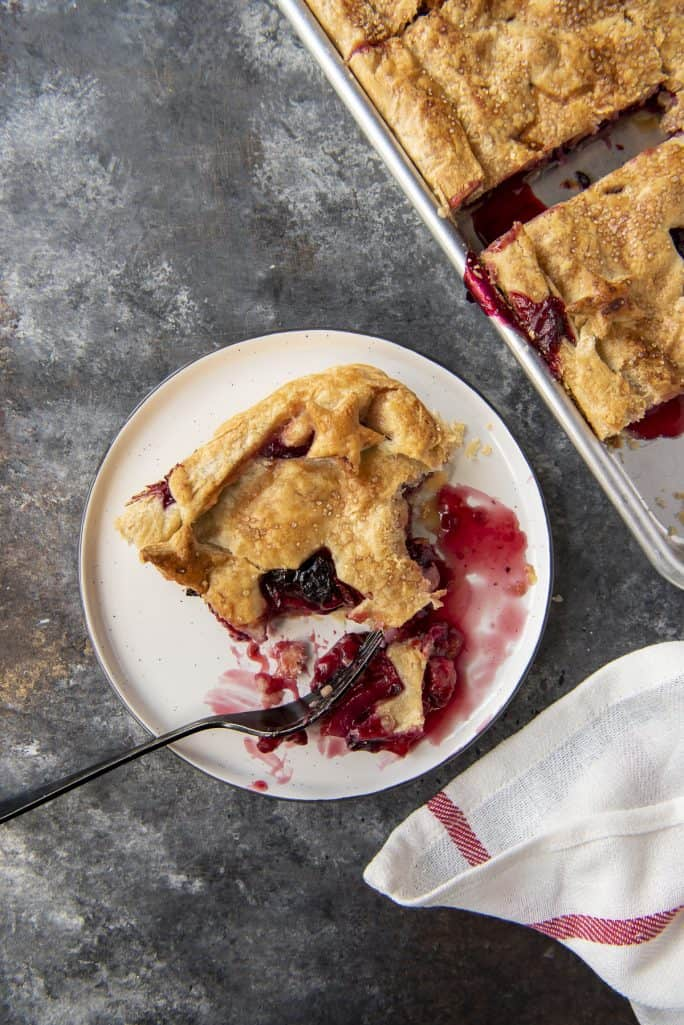 Triple Berry Slab Pie being eaten